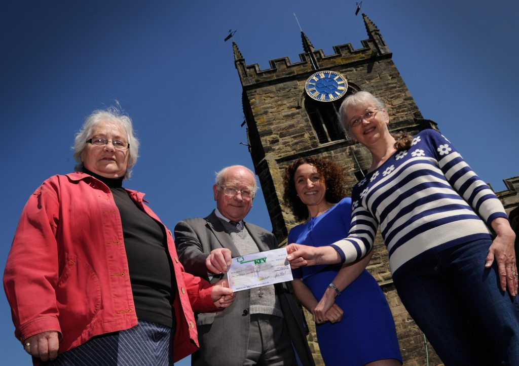 Cheque presentation by Julie to Sue and Roy at St James Church. Lizzie Butler from Smith of Derby was privileged to be invited to the presentation. L to R: Sue Gent Churchwarden; Roy Smith former Clockwinder St James Church; Lizzie Butler Smith of Derby Clockmakers and Julie Skinner Trustee of the Barton & Dunstall Key Trust.