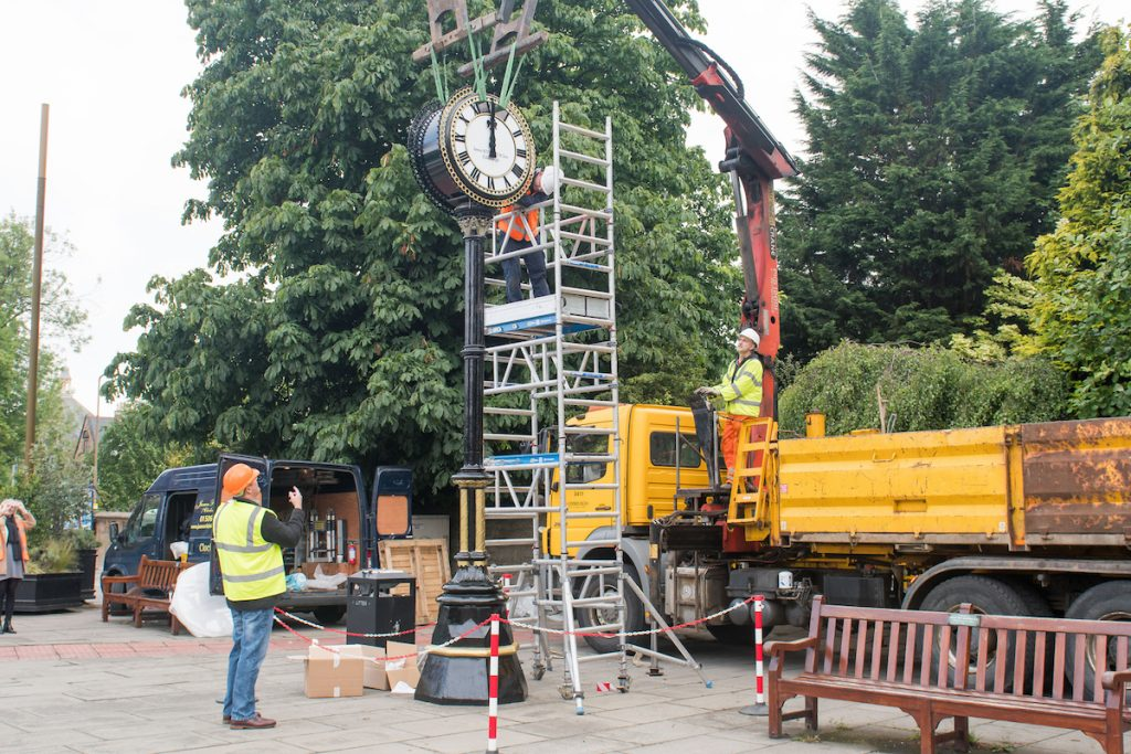 WWW.IANGEORGESONPHOTOGRAPHY.CO.UK Picture: The Fully Restored Morningside Clock was put back in position today after being refurbished by James Ritchie and sons which took just over 6weeks. Engineer Craig Park (Orange Vest) and Sales Manager Tony Charlesworth (Yellow vest)