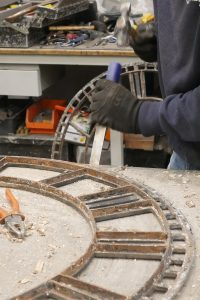 Clearing the old glazing cement from the skeleton dial