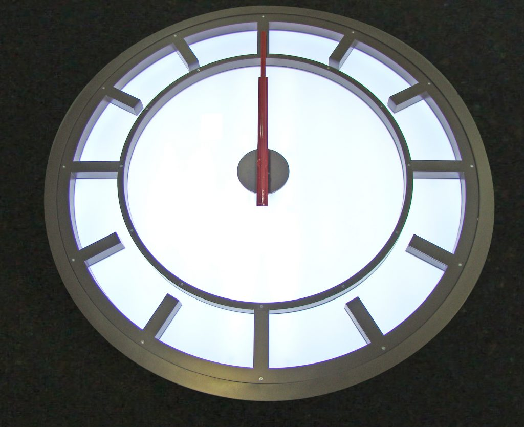Design and manufacture and install four 1.6m diameter clock cases.