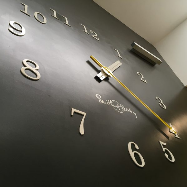 Clock in the stairwell at Derby University